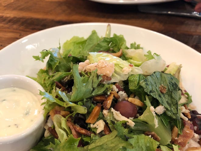 Smoked grape salad at the new Roam Kitchen + Bar at The District.