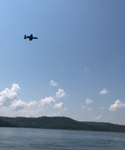 An A-10 Thunderbolt, flying out of Whiteman Air Force Base, practices low altitude tactical navigation over Table Rock Lake.
