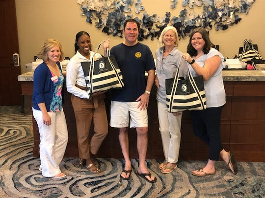 Blake Dowling and friends show off their Chamber Conference swag bags.