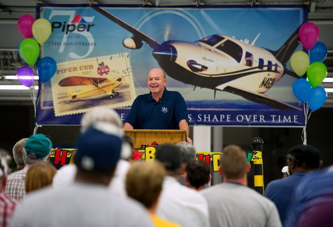 Simon Caldecott, the president and CEO of Piper Aircraft, Inc., spoke to his employees during a brief meeting on March 20, 2012, at the plant in Vero Beach. Piper marked the 75th anniversary of the company that year, as well as the Piper Cub airplane.