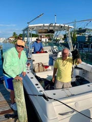 The group of fishermen pose in relief after nobody was seriously injured when lightning struck their boat AUg. 10, 2019, said 71-year-old Martin County resident George Haddad.