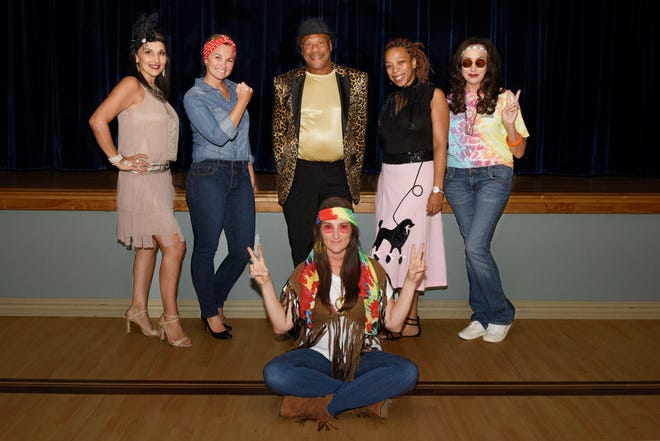 Kane Center staff and sponsors, from left, Christine Rigg, Chelsey Matheson, Daryl Magill, Soraya Henry, Marianne Salem and Crystal Collier, seated, represent the great eras of the 20th Century for the Sept. 26 Decades Dance fundraiser.
