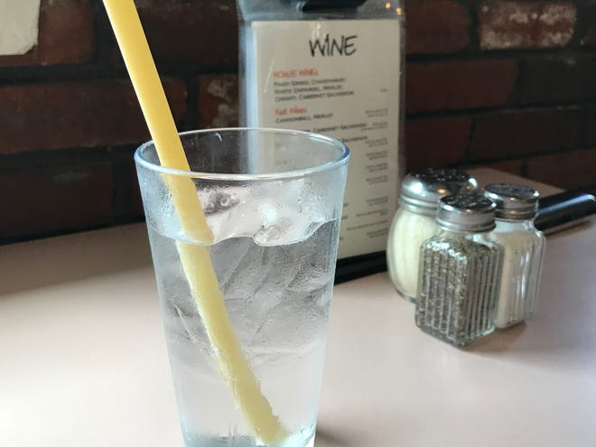 At Pappa Louie's Italian Restaurant in Port St. Lucie, Fla., a glass of water is served with a pasta straw, Friday, July 12, 2019.