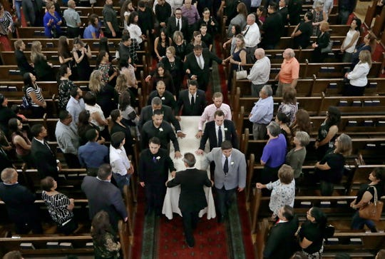 Pallbearers walk the casket of Andre Anchondo after a funeral Mass at St. Patrick Cathedral led by the Catholic Diocese of El Paso Bishop Mark J. Seitz on Friday, Aug. 16, 2019, in El Paso. Anchondo was among the 22 killed in the mass shooting at Walmart. He was killed while protecting his wife and newborn son. His wife, Jordan, also was killed.