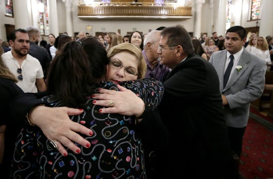During the funeral mass for her son Andre Anchondo, Brenda Anchondo, his mother, is comforted by loved ones at St. Patrick Cathedral. Anchondo was one of the 22 victims in the mass shooting at Walmart on August, 3.