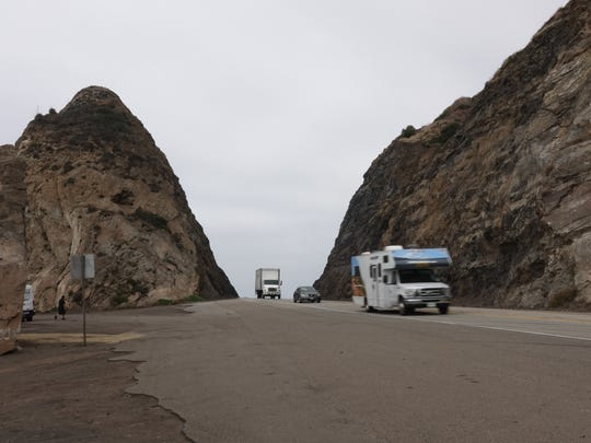 A marine layer hangs over Mugu Rock on Pacific Coast Highway late Friday morning.