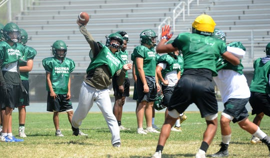 Quarterback RJ Maria fires a pass during a Pacifica High practice. The returning starter will lead a dynamic offense.
