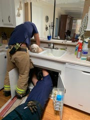 Santa Barbara County firefighters rescued a dog in Orcutt on Thursday after it got stuck in a kitchen sink while getting a bath.