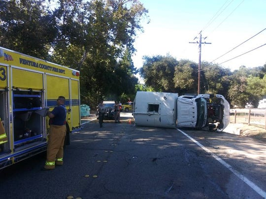 Ventura County firefighters at scene of overturned water tender on Creek Road Friday.