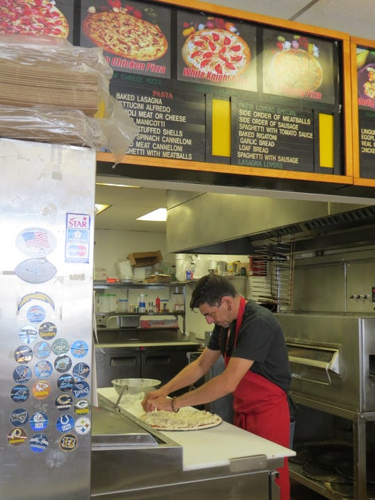"Eddie Wahezi makes a pizza at Freddy's Pizza, a longtime Oxnard restaurant that was recently renamed in honor of his late brother-in-law, Abdul Farid ""Freddy"" Majeed."