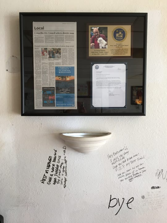 "A shadow box containing a letter of appreciation and a plaque honoring late Oxnard pizzeria owner Abdul Farid ""Freddy"" Majeed hangs on the wall at the newly renamed Freddy's Pizza."