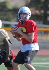 Simi Valley High quarterback Jack Applegate looks for one of his receivers downfield during a recent practice.