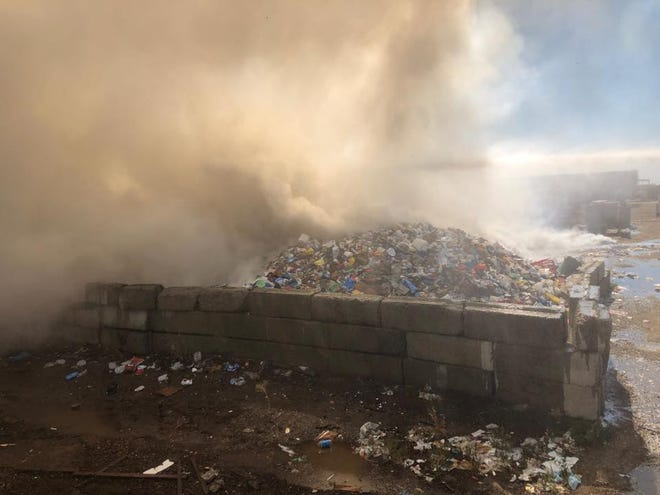 A two-alarm fire tore through Peña's Disposal Service's Cutler recycle center on Aug. 15, 2019. Tulare County firefighters worked through the night to contain the blaze and thwart further damage,
