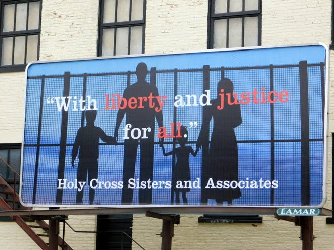 The downtown Merrill billboard, sending  a message from the Holy Cross Sisters, will be displayed for 12 weeks.