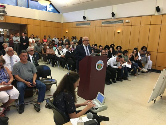 Planner Jonathan Lockman speaks for civi group about Pascack Ridge development scheme during public hearing in Ramapo Town Hall on Aug. 15, 2019