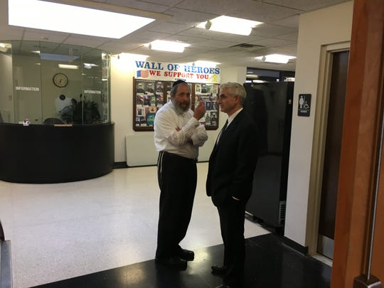 Pascack Ridge developer Alex Goldberger, left, talks with his attorney Daniel Richmond before public hearing on zone  change in Ramapo Town Hall on Aug. 15, 2019