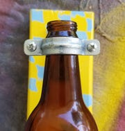 Do not overtighten the screws. you want the ring tight enough so the bottle doesn't slip out, but you should be able to twist the ring around the bottle neck, with little effort.