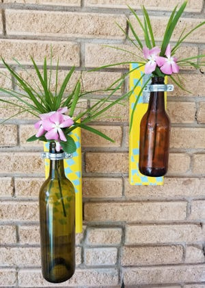The ring should be attatched securely, but the bottle should be able to swing freely. Now, hang it where you would like it, fill with water and place your favorite flowers in it.