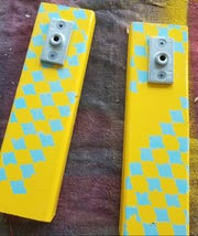"""Step Three: Turn the board face up. Measure down 1"""" from the top edge and make a mark. Place the ceiling flange vertically on the board, make sure it is level and straight and align the top edge with the mark you just made."""