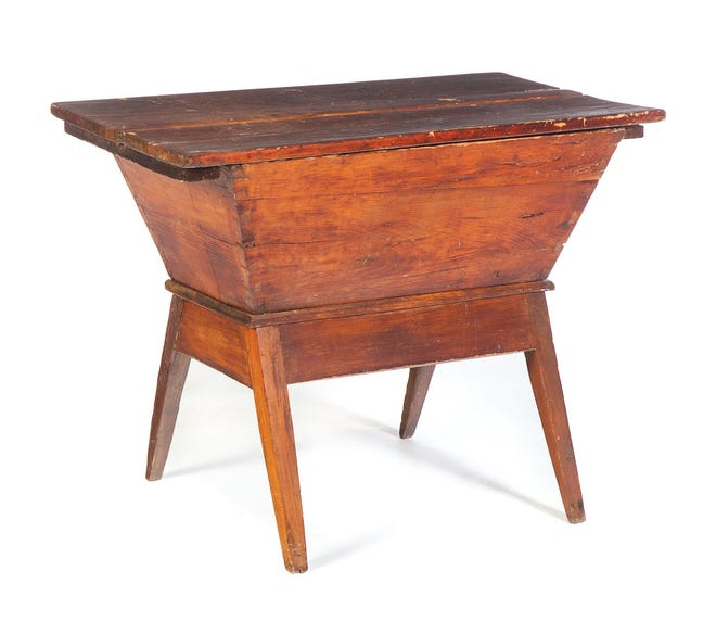 This pine dough box was made in the 1850s. It sold for $219 at a Garth's auction. Country furniture is selling for low prices, but there seem to be more pieces sold at flea markets than during the past few years.
