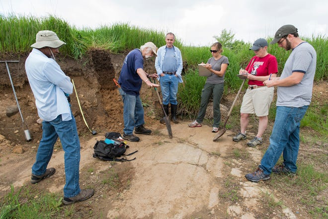 From left, soil science professors Birl Lowery, Fred Madison and Kevin McSweeney describe layered features of vertically exposed prairie soil during a soil science class field trip to the University of Wisconsin-Madison's Arlington Agricultural Research Station on May 27, 2014.