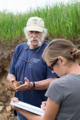 Fred Madison, professor emeritus of soil science, describes layered features of vertically exposed prairie soil during a soil science class field trip to the University of Wisconsin-Madison's Arlington Agricultural Research Station on May 27, 2014.