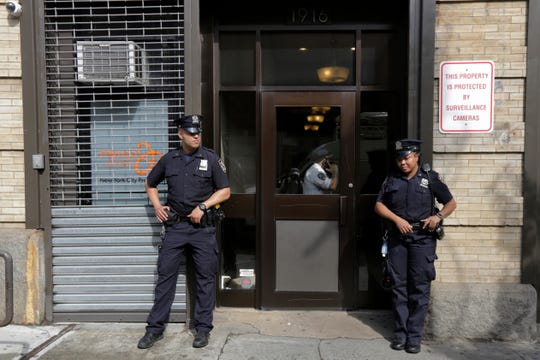 In this Thursday, June 21, 2018 file photo, police stand outside an office for the Cayuga Centers in the Brooklyn borough of New York.