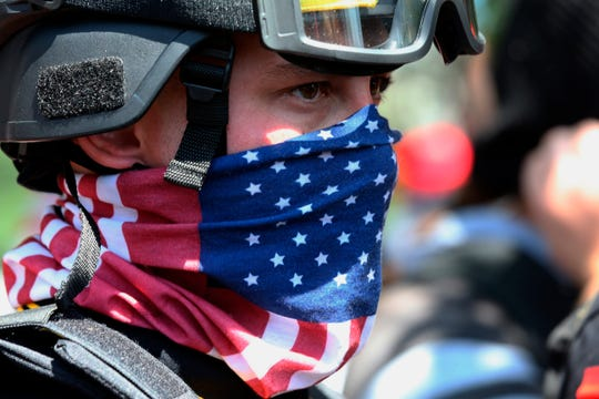 In this Aug. 4, 2018, file photo, a protester participates in a rally in Portland, Ore. Portland police are mobilizing in hopes of avoiding clashes between out-of-state hate groups planning a rally Saturday, Aug. 17, 2019, and homegrown anti-fascists who say they'll come out to oppose them.