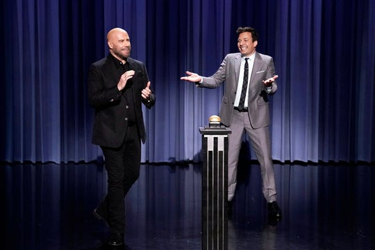 Welcome back! John Travolta re-enacts his iconic roles Danny Zuko and Vinnie Barbarino