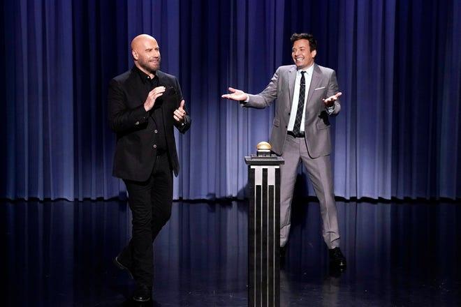 "John Travolta and Jimmy Fallon battle during a ""John Travolt-Off"" on Aug. 15, 2019."
