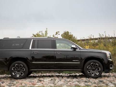 Versus the regular-length Yukon, the Yukon XL (shown) adds 14 inches of wheelbase and 20.5 inches of length.