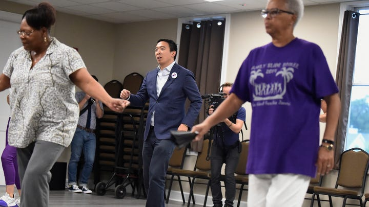 Democratic presidential hopeful and former technology executive Andrew Yang participates in a line dance class during a campaign stop at the Black Chamber of Commerce on Thursday, Aug. 15, 2019, in Beaufort, S.C. (AP Photo/Meg Kinnard)