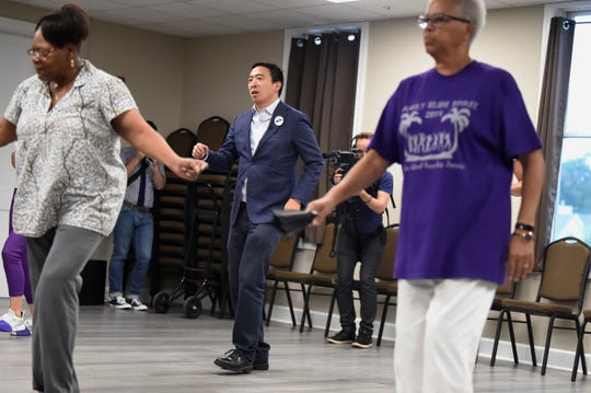 Democratic presidential hopeful and former technology executive Andrew Yang participates in a line dance class during a campaign stop at the Black Chamber of Commerce on Aug. 15 in Beaufort, S.C.
