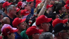"Supporters of US President Donald Trump cheer during a ""Keep America Great"" campaign rally at the SNHU Arena in Manchester, N. H. on August 15, 2019."