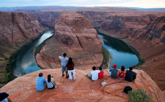 FILE - In this Sept. 9, 2011 file photo visitors view the dramatic bend in the Colorado River at the popular Horseshoe Bend in Glen Canyon National Recreation Area, in Page, Ariz. Some 40 million people in Arizona, California, Colorado, Nevada, New Mexico, Utah and Wyoming draw from the Colorado River and its tributaries.