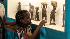 Else Adelaide and her family look at exhibits at the National Museum of Slavery in Morro Da Crus on Sunday, July 28, 2019.