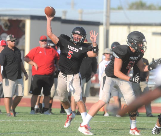 Anson senior quarterback Drew Hagler (5) throws a pass during a scrimmage against Colorado City on Friday, Aug. 16, 2019, at Tiger Stadium in Anson.