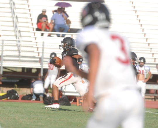 Anson receiver Issak Fernandez, background, runs down the sideline for a touchdown in a scrimmage against Colorado City on Friday, Aug. 16, 2019, at Tiger Stadium in Anson.