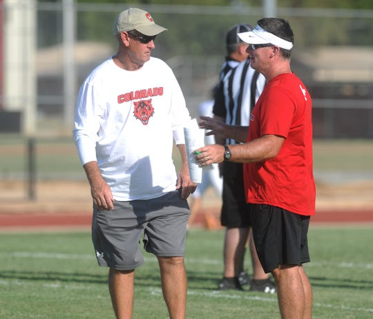 Colorado City coach Dan Gainey, left, and Anson coach Chris Hagler meet before the teams' football scrimmage Friday, Aug. 16, 2019, at Tiger Stadium in Anson.