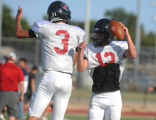 Colorado City defenders Maverick Hale (3) and Zach Thompson celebrate after Thompson's interception in a scrimmage against Anson on Friday, Aug. 16, 2019, at Tiger Stadium in Anson.
