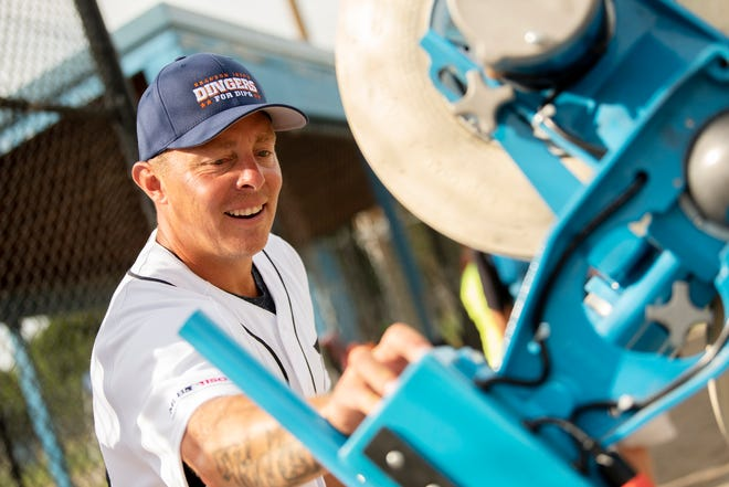 Former Detroit Tigers third baseman and catcher Brandon Inge loads a JUGS machine during the Dingers for DIPG fundraiser on Saturday, Aug. 17, 2019 at Bailey Park in Battle Creek, Mich. DIPG, Diffuse Intrinsic Pontine Glioma, is a brain tumor that can't be surgically removed and affects bodily functions such as breathing and swallowing.
