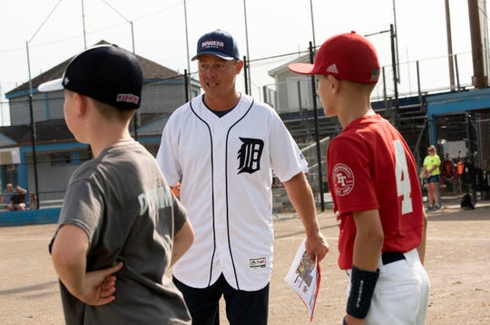 Former Detroit Tigers third baseman and catcher Brandon Inge works with kids during the Dingers for DIPG fundraiser on Saturday, Aug. 17, 2019 at Bailey Park in Battle Creek, Mich.DIPG, Diffuse Intrinsic Pontine Glioma, is a brain tumor that can't be surgically removed and affects bodily functions such as breathing and swallowing.