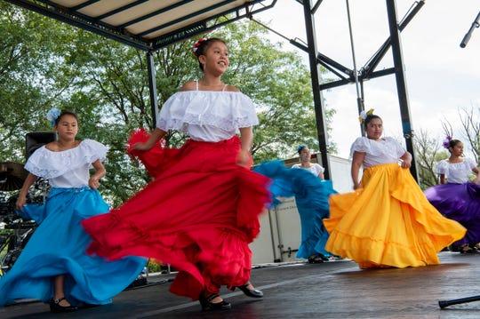 El Concilio dancers perform during Battle Creek's International SummerFest on Saturday, Aug. 17, 2019 at Kellogg Community College in Battle Creek, Mich.