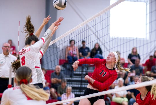 Crestview's Autumn Bailey hits the ball over the Buckeye Central defense.