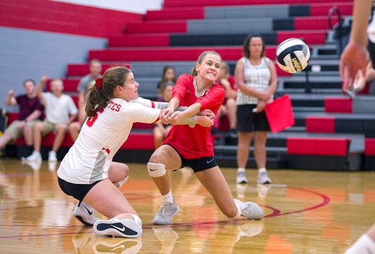 Buckeye Central's Lydia Ackerman and Parker Phenicie go for the ball.