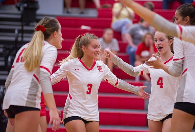 Buckeye Central celebrates after a block at the net.