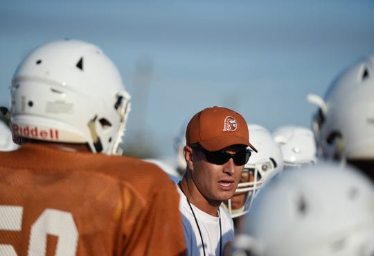 Eric Soza, seen here in a huddle during a recent scrimmage, returned to Beeville to coach with his father, Eric on the football team.
