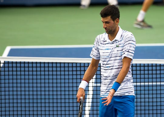 Novak Djokovic argues about a called ball on the line during the Western & Southern Open tennis tournament semi-final match on Saturday, Aug. 17, 2019, in Mason.