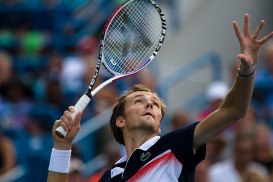 Daniil Medvedev serves to Novak Djokovic during the Western & Southern Open tennis tournament semi-final match on Saturday, Aug. 17, 2019, in Mason.