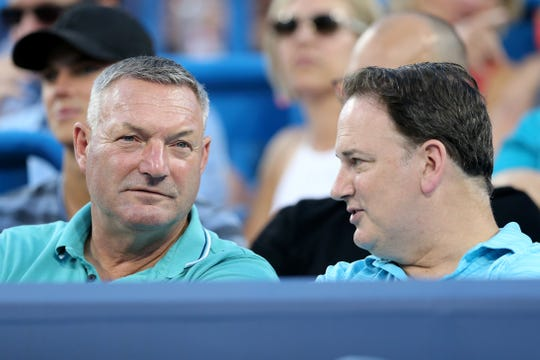 FC Cincinnati manager Ron Jans, left, and general manager Jeff Berding, right, talk during a quarterfinal match between Madison Keys and Venus Williams of the Western & Southern Open tennis tournament, Friday, Aug. 16, 2019, at the Lindner Family Tennis Center in Mason, Ohio.